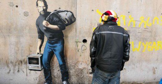 Em novo graffiti, Banksy lembra que Steve Jobs era filho de refugiado sírio