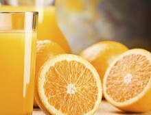 cut oranges and juice in glass