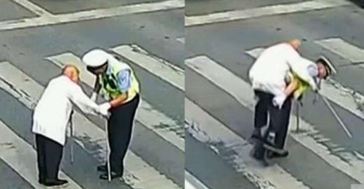 Gentileza no trânsito: guarda carrega idoso para atravessar rua