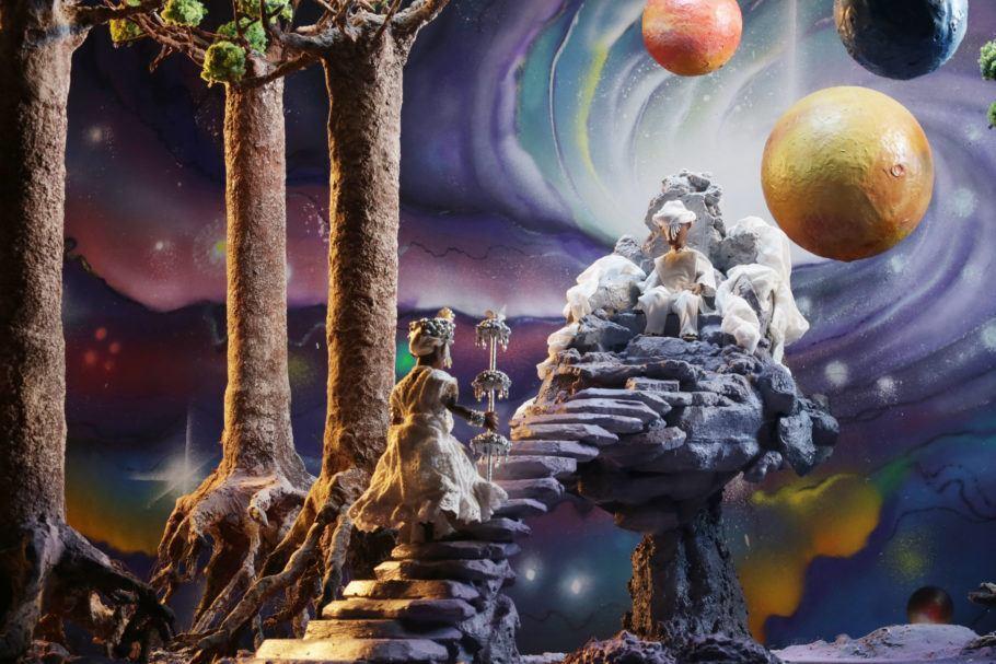 Pintura de Orixá subindo uma escada em direção a outro Orixá com o universo ao fundo