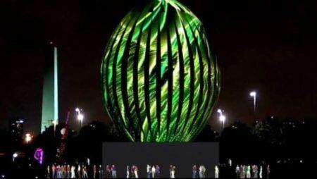 ovo de páscoa gigante feito de metal com luzes projetadas