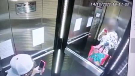 bandido tira selfie no elevador com roupão da vítima