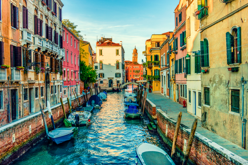 Colorful-canal-Venice-with-Boats-and-Church-in-Backgraund-000051767636_Small