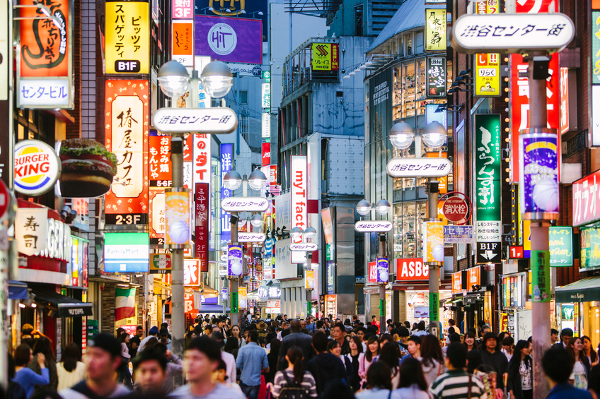 People walking in Shibuya  shopping district.